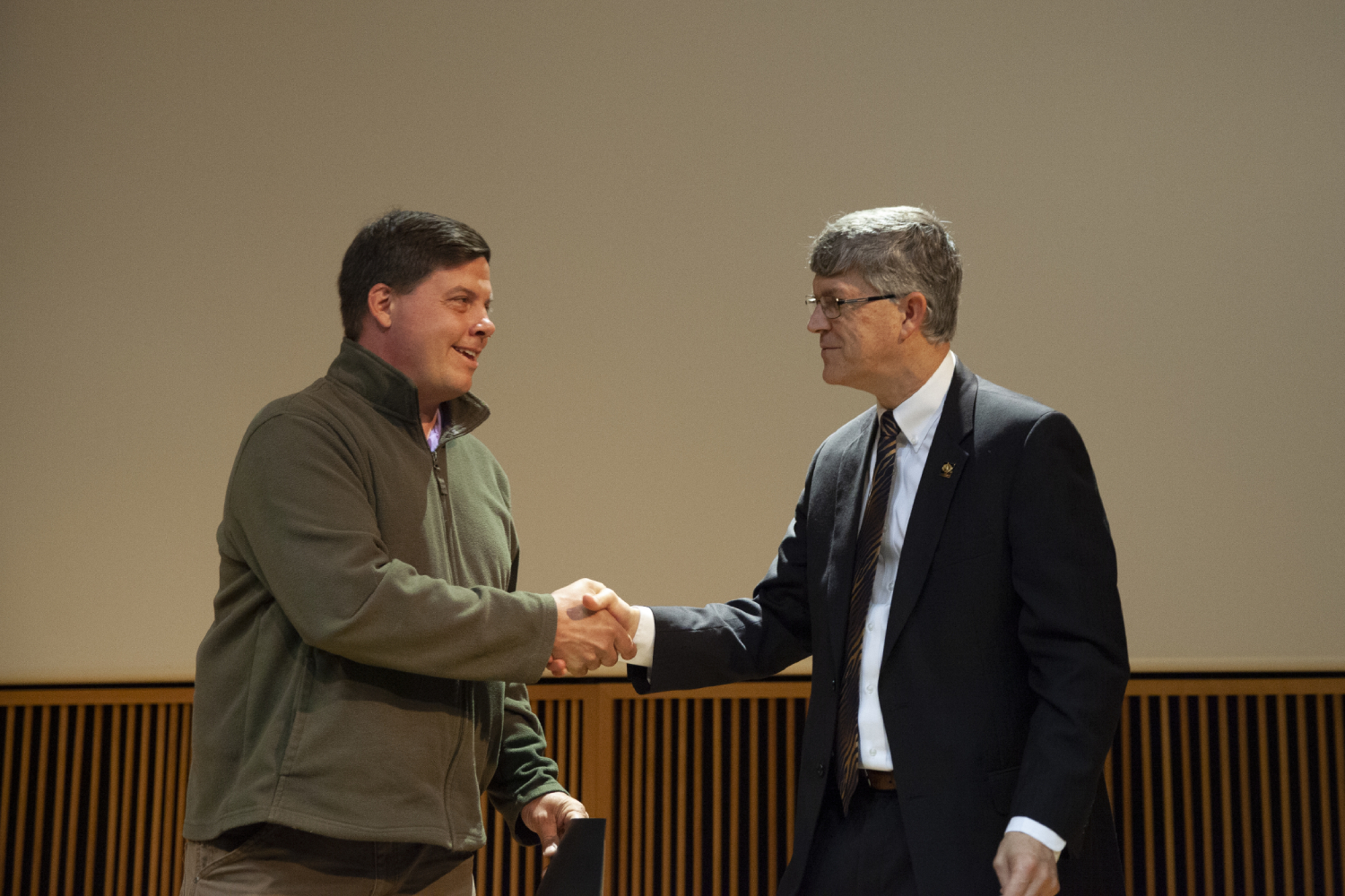 Jim Spain, Vice Provost of Undergraduate Studies, congratulates Ferris Pfeiffer, assistant professor in biomedical, biological and chemical engineering, for receiving the Research Mentor of the Year Award.