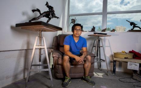 Artist Kiet Le poses in his studio.