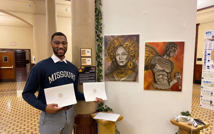 Portrait of Tyree Taylor in front of is 2020 VADS display