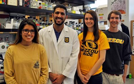 Dallas Pineda, Edward Duqum, Katie Wilsdon and Nathan Coffey in a science lab